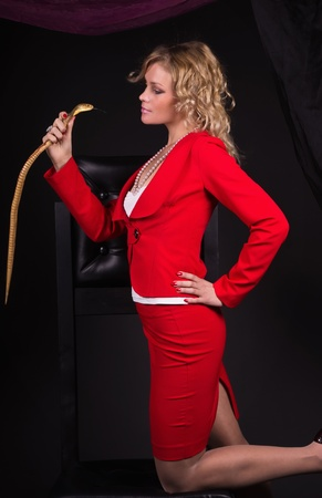 Sensual young lady in red with snake photo
