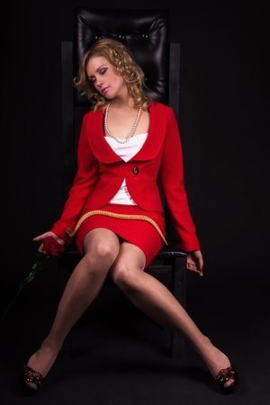 Sensual lifeless lady in red with snake photo