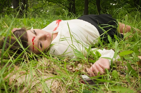 Crime scene in a wood with dead secretary