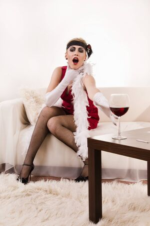 Poisoned wine. Beautiful young woman in red choking photo