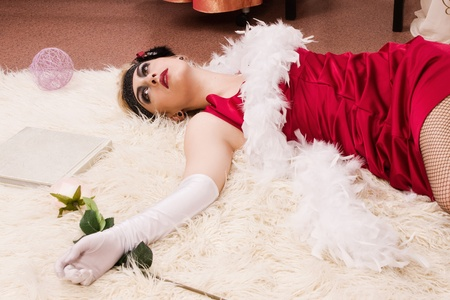 Crime scene in a retro style. Dead woman lying on the floor photo