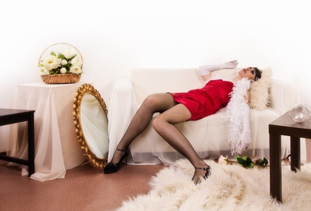 Crime scene in a retro style. Killed woman lying on the sofa Stock Photo - 10241187