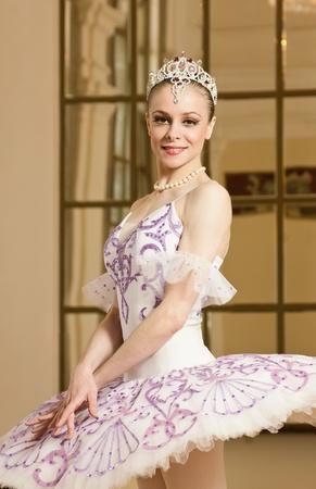 Portrait of the ballerina in the rich interior photo