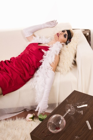 swooned: Crime scene in a retro style. Lifeless  woman lying on the sofa Stock Photo