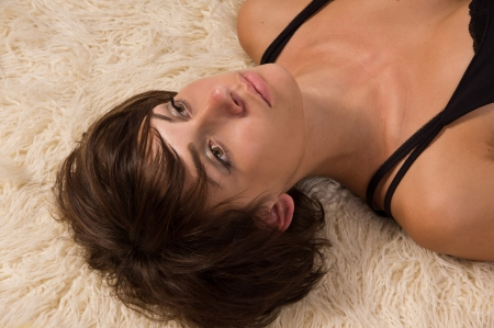 homicide: Lifeless pretty woman lying on the floor Stock Photo