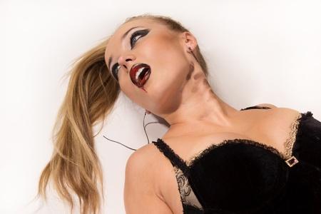 Crime scene simulation: strangled  blonde lying on the floor photo