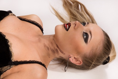 dirty bussines: Crime scene simulation: pretty blonde in the handcuffs lying on the floor Stock Photo