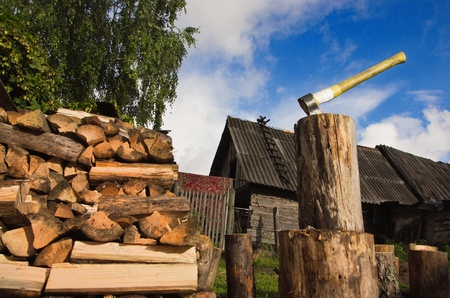 Axe in log on a firewoods background Stock Photo - 10632053