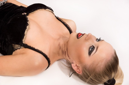 Crime scene simulation: pretty blonde lying on the floor photo