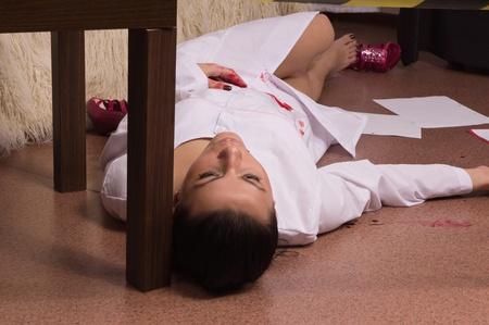 Crime scene simulation: dead nurse lying on the floor Stock Photo - 11010215