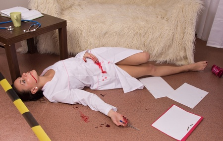 Crime scene simulation: dead nurse lying on the floor Stock Photo - 11010216
