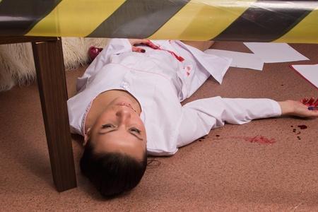 Crime scene simulation: dead nurse lying on the floor Stock Photo - 11010213