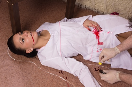 actress girl: Forensic expert collecting evidence in a crime scene (imitation) Stock Photo