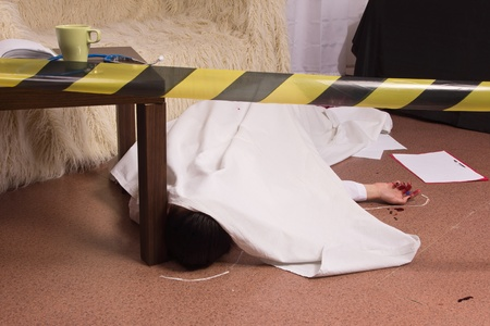 Crime scene simulation: victim lying on the floor photo