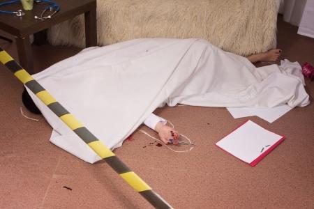 Crime scene simulation: victim lying on the floor photo