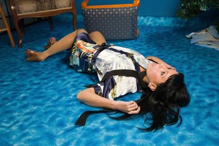 csi: Crime scene simulation: strangled  brunette lying on the floor