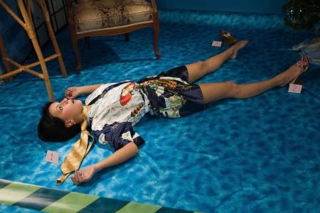 homicide: Crime scene simulation: strangled  brunette lying on the floor