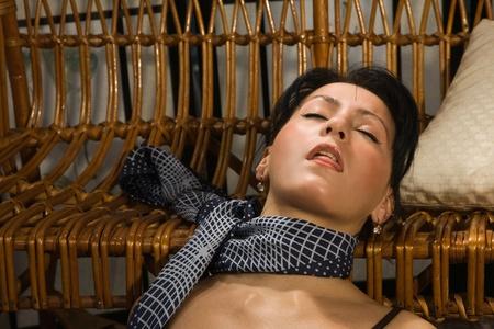 to strangle: Crime scene simulation: strangled  brunette lying on the floor