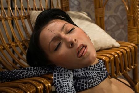 hostage: Crime scene simulation: lifeless  brunette lying on the floor