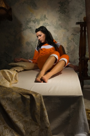 Sensuality brunette relaxied  in a luxury bedroom photo