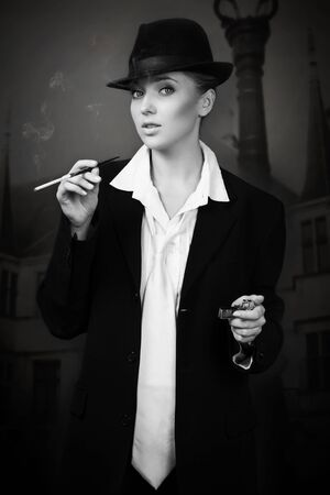 Beautiful woman smoking on the night city street photo