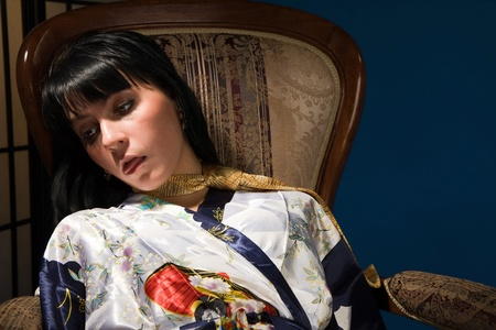 actress girl: Crime scene simulation: lifeless  brunette sitting on a armchair
