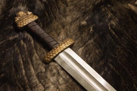 karoling: Still life with ancient scandinavian sword on a fur