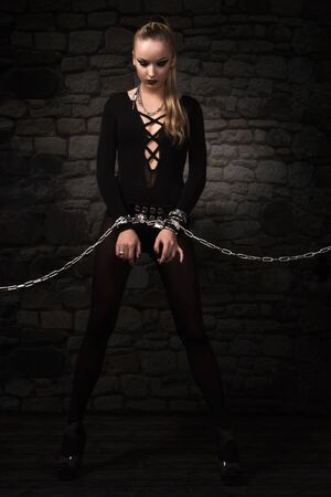 demoniacal: Portrait of a vampire girl in a silver chains Stock Photo