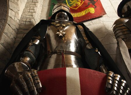 Medieval knight - crusader in a castle interior   photo