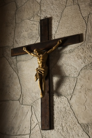 Statue of Jesus Christ crucifixion on a stone wall