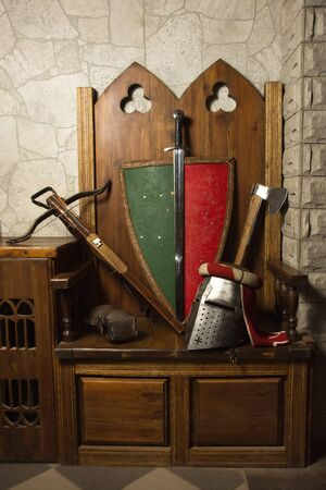 Medieval weapons: sword, shield, axe, arbalet, plate and helmet photo