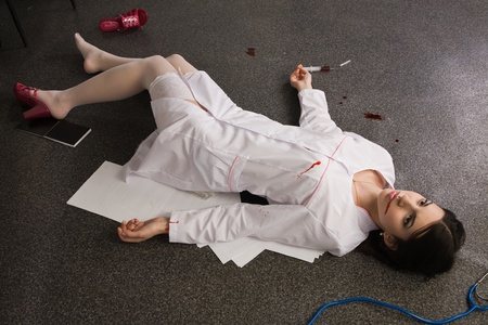 Crime scene imitation. Nurse lying on the floor photo