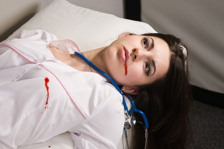 forensic medicine: Crime scene imitation. Nurse lying on the sofa