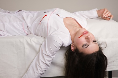 Crime scene imitation. Nurse lying on the sofa Stock Photo - 11432896