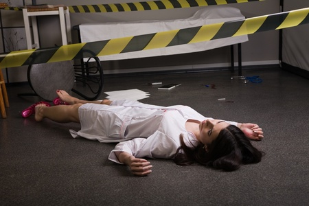 Crime scene imitation. Nurse lying on the floor Stock Photo - 11432912