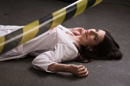 corpse: Crime scene imitation. Nurse lying on the floor Stock Photo