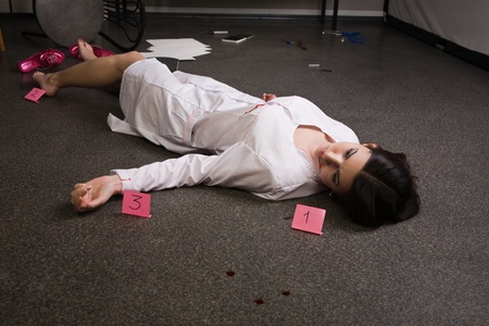 Crime scene imitation. Nurse lying on the floor Stock Photo - 11432927
