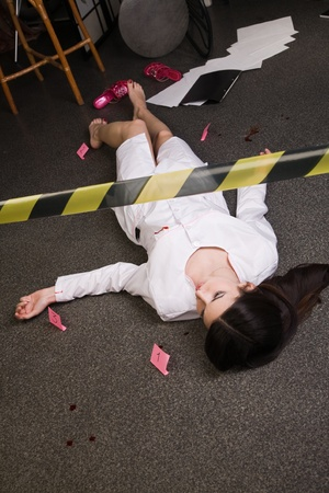Crime scene imitation. Nurse lying on the floor Stock Photo - 11432931