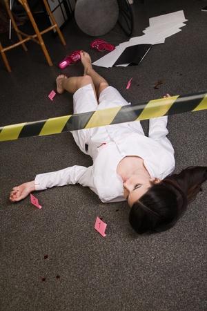 Crime scene imitation. Nurse lying on the floor Stock Photo - 11432931