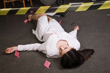 Crime scene imitation. Nurse lying on the floor Stock Photo - 11432926