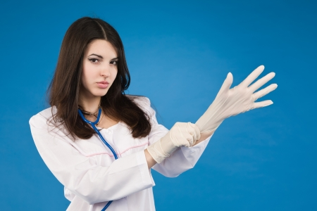 Medical person: Nurse / young doctor portrait. Confident young woman Stock Photo - 11432881