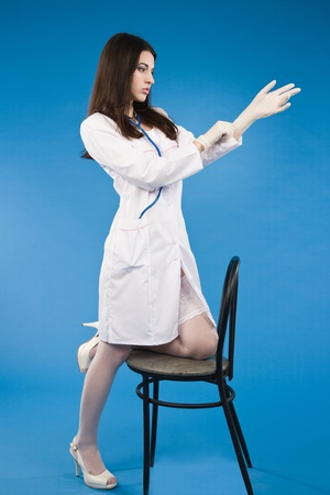 Medical person: Nurse / young doctor portrait. Confident young woman photo