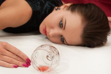 poisoned: Crime scene simulation: poisoned  brunette lying on the floor