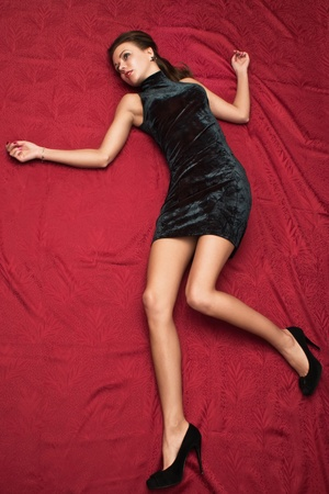 Crime scene simulation: dead  brunette lying on the floor Stock Photo - 11432944