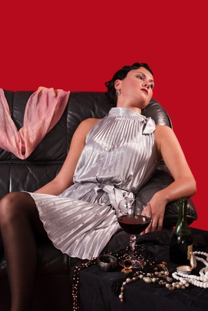 swooned: Crime scene in a retro style. Poisoned woman on the sofa