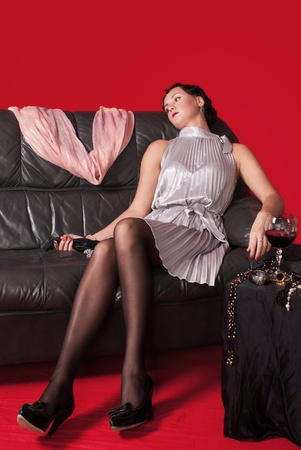 Crime scene in a retro style. Poisoned woman on the sofa photo
