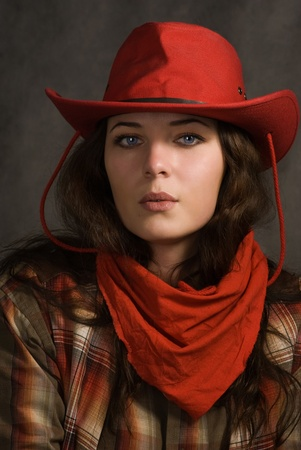 brown leather hat: Portrait of a cowgirl in a hat. Western movie style