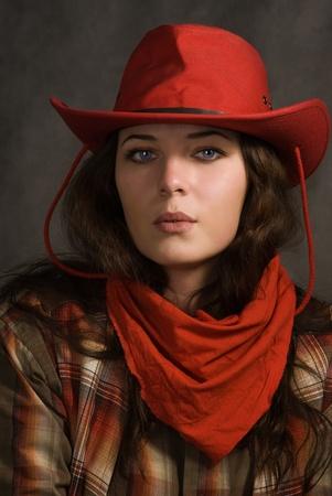 Ritratto di una cowgirl in un cappello. Film in stile occidentale Archivio Fotografico - 11432910
