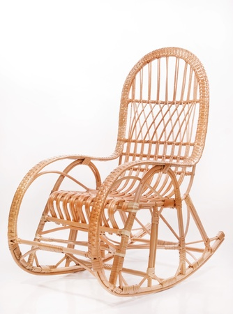 Old wooden rocking chair over white background   photo