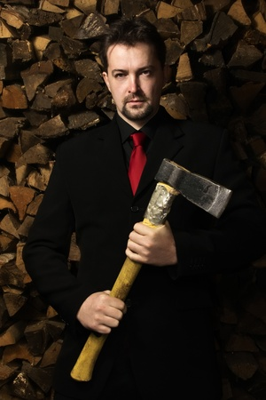 Confident business man with the axe   photo
